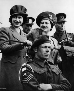 World War II. Back row, from left Future Queen of England Princess Elizabeth, Queen Mother Elizabeth, King George VI, during a military review, 1944.