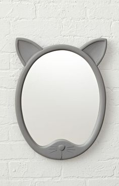 Shop Decorative Cat Shaped Mirror. This cat-shaped wall mirror was designed for anyone who's ever wanted to see things from a feline perspective. It features two perky ears on top of a round wood frame and can be hung in any kids room or nursery.