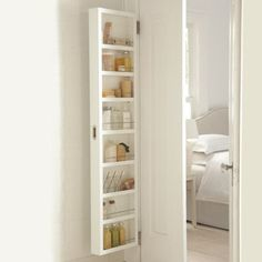 Concealable Door Storage Cabinets - I desperately need this for Texas