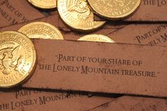 "Gold chocolate coin with the note: ""Part of your share of the Lonely Mountain treasure."""