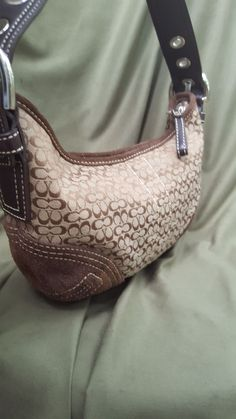 Brown Coach handbag with signature Coach logo print and brown leather trim and handle Lining is like new Gently loved and in great condition FREE DOMESTIC SHIPPING!!