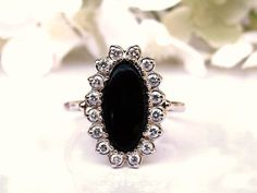 An elegant and classic look from the past with black onyx, diamonds and gold that never goes out of style! The center of attention is an