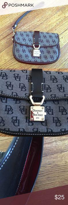 Black Dooney and Bourke Wristlet Black Dooney and Bourke Wristlet. Small in size. In good condition. Dooney & Bourke Bags Clutches & Wristlets