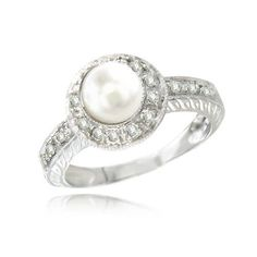 Pearls = my favorite. Diamonds = apparently my new obsession. This ring = A MUST HAVE!