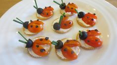 Ladybird crackers Cream cheese, cherry tomatoes, black olives & chives