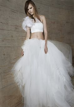 Look 18. Ivory strapless bra with hand draped tulle detailing and organza flower technique. Ivory tulle ball gown skirt with ruched details.