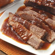 Barbecue Beef Brisket Recipe _ This is such a simple dish, but oh boy is it delicious. The meat comes out moist and tender and tastes great with mashed potatoes.