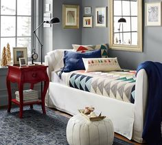 Daniella Bedside Table | Pottery Barn. I love the combination of modern, muted gray walls with the bright primary red and blue. They cld have improved in the rug choice...  A bit twee.