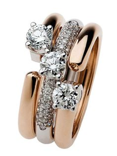 Damiani. Three in one is Polello. Convertible jewelry: earrings together to create a precious solitaire ring, rings in rose gold with diamonds blacks and whites joined together make up one fourth ring and earrings, pendant and Eternity result in a white gold ring with pavé diamonds.