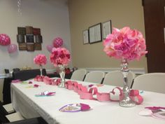 Super simple table decor: stick fake flowers from the dollar tree into styrofoam balls and place atop candlesticks.