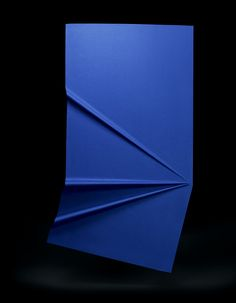 Robert Stadler - Pli Bleu, Pli Violet 'My intention was to show the quality of the textile in the most pure and direct way possible. The two pleated monochromes catch the ambient light in a subtle way,'  Some of the folds can be used as a shelf, creating a deliberate ongoing dialogue between the sculptural and functional elements of the piece.