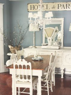 love the mismatched chairs and the blue and white combo