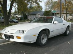 1985 Chevy Camaro V6. My daddy had one when I was growing up but had to get rid of it....for $150!!!! Wtf!!! Then again we lived in an apartment & couldnt keep 3 cars, plus the motor blew out in it and he had to get rid of it;( Now and always will I be obssesed with this until I get one, fix it up as I wish!!