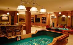 Here's+a+large+finished+basement+with+gambling+tables,+bar+and+entertainment+area