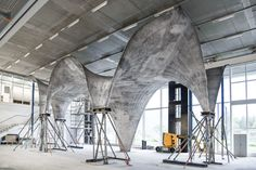 New concrete roof includes thin film PV cells to generate power // @inhabitat