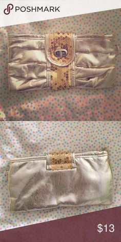 Gold clutch NEW. Good condition. Never used. Gold sequencing in the middle. (No tags) Bags Clutches & Wristlets