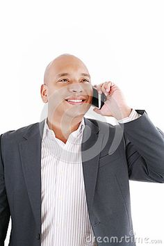 African American business man talking by David Castillo Dominici, via Dreamstime