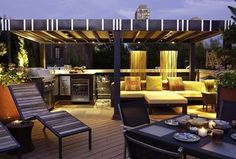 Contemporary Deck with Custom Patio Cover Design, Outdoor kitchen, Talt chaise lounge, Fire pit, exterior tile floors