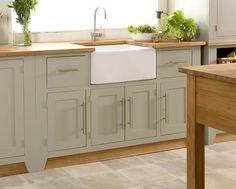 farrow & ball french grey with wood countertops...our kitchen might look a lot like this when we're done!  (except no modern pulls...cup pulls and old fashioned latches please)