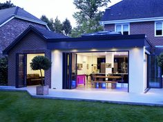https://flic.kr/p/czQcQu | Orangery Kitchen Extension | This open plan kitchen design is both modern and in keeping with the original style of it's host property. Folding sliding doors allow both wings to be opened onto the garden entirely whilst filling the rooms with light. The large skylight situated within the roof of the orangery also provides more natural light giving the entire structure an open, calm atmosphere. For more information visit our blog at: www.aproposapropos.com