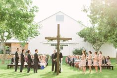 outdoor ceremony by the barn | Mustard Seed Photography
