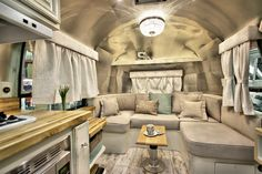 Interior living space of our custom-designed shabby chic 1967 Overlander Airstream trailer.