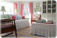 Simple living room. Cozy and shabby white with bright retro pillows.  Perfect.