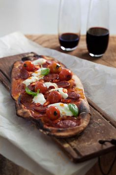Pepperoni or favorite sausage rounds, basil, mozzarella, roasted cherry belles over a balsamic garlic sauce
