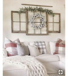Farmhouse look with small & large windows decorated with a wreath and greenery.