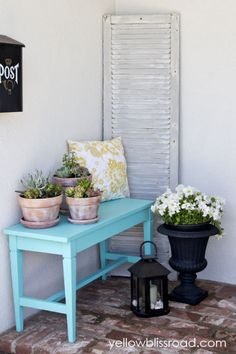 This slim seating fits neatly against any wall. Top it with succulents to add a layer of decoration, and stow them underneath when entertaining a larger crowd. Don't forget outdoor-friendly pillows or cushions for added comfort. Click through for more on this and other small patio decor ideas.