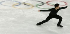 Figure skater Chan of Canada skates during a figure skating training session in preparation for the 2014 Sochi Winter Olympics, in Sochi