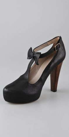 T-Strap Platform Pumps. Super cute but I would sooner chew off both my feets before I dropped  $436.00 on these bad boys. I KNOW I can find a cheaper version!