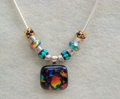 ON SALE ! 25% OFF Fused Glass Multicolored Dichoric Glass Pendant Necklace with Hand Woven Beads.Teal, Black and Amber Fused Glass Pendant - pinned by pin4etsy.com