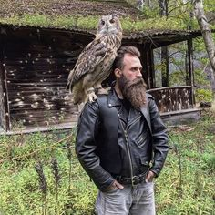 Besrded man and his owl
