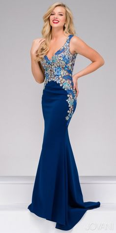 Be the definition of dreamy in this Beaded Floral Applique Jersey Evening Dress by Jovani. This stunning style includes a gorgeous V-shape neckline with a matching plunging V shape back. The bodice is adorned with cascading floral embroidery that is covered in beading, and overlays illusion panels. This jersey mermaid silhouette is sure to keep everyone's eyes on you all night long! #edressme