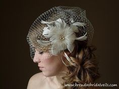 For the brides that like the vintage style birdcage veil. Still have the loose curls pulled to the side is a ponytail like style. Very Beautiful!!