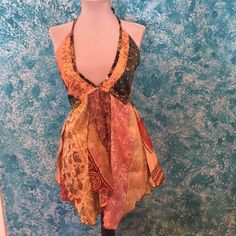 Very cute 100%silk shirt.  Ties around your neck. Very cute and cool summer top. Says it's a small but can fit medium because it has elastic in the back Just cruising Tops Tank Tops