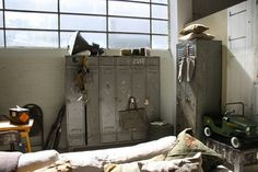 Best of the Past - Industrial Vintage lockers and lamp in a great 'man cave' @ Loods5 Zaandam. A six door beauty and double door French big brother, and original vintage factory lamps in army green...