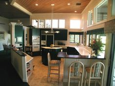 Nice layout to the kitchen. Also nice placement of the windows to let the natural lighting in.