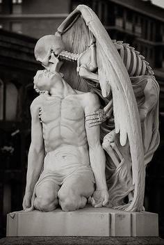"Located at Barcelona's Poblenou Cemetery, this magnificent sculpture, titled Kiss of Death (El Petó de la Mort in Catalan and El Beso de la Muerte in Spanish), depicts death (in the form of a winged skeleton) planting a kiss on a young man's forehead. The epitaph bears famous verses by one of Catalan's greatest poets, Jacint Verdaguer: ""And his young heart can not help; in his veins the blood stops and freezes, And encouragement lost faith embraces, Fall feeling the kiss of death."""