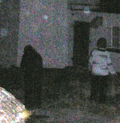 Taken six years ago outside lighthouse keepers cottage at Blackhead lighthouse, Whitehead County Antrim. My friend was smoking in the dark and we only noticed the figure when viewing the photos. No idea what it is or why and there were three of us at the lighthouse. I did hear strange whispers in my ear in the cottage. No idea what this is or why. Submitted by Laura A. County Down, Northern Ireland