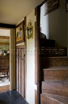 Wooden staircase with under stairs cupboard in timber framed cottage Grafty Green Kent England U Wooden Staircases, Stairways, Under Stairs Cupboard, Kent England, Interior Photography, Wooden House, Buildings, Around The Worlds, Cottage