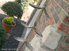 Inspirational Homemade Rain Chain from recycled spoons perfect for a woman with a flatware