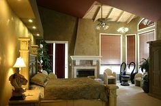 Bedroom with tall ceiling in earth tones