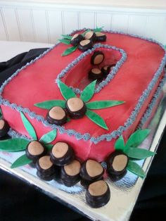 Cake is covered with buttercream. Buckeye candies and the leaves are made from fondant