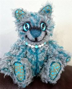 Check out this item in my Etsy shop https://www.etsy.com/uk/listing/582654574/cheshire-kitten-grey-and-teal-artist