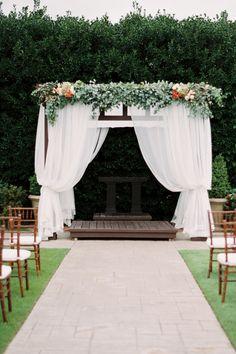 Preppy garden wedding ceremony decor: http://www.stylemepretty.com/oklahoma-weddings/oklahoma-city/2016/01/20/pretty-preppy-autumn-garden-wedding/ | Photography: Emily Ann Hughes - http://www.emilyannhughes.com/