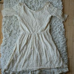 All Over Lace Dress Lace dress with a lower back worn a few times has loops for a belt. Sleeves just got too tight on me Rewind Dresses