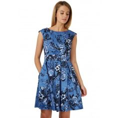 This blue denim dress is cut in our classically flattering Portobello shape, which has  gathering detail around the bust, a waist belt and a pleated skirt. The beautiful floral pattern decorating the piece is on trend for this season, as the catwalks are covered with flowers. Pair with baby blue heels for a pretty and feminine outfit for day or night.