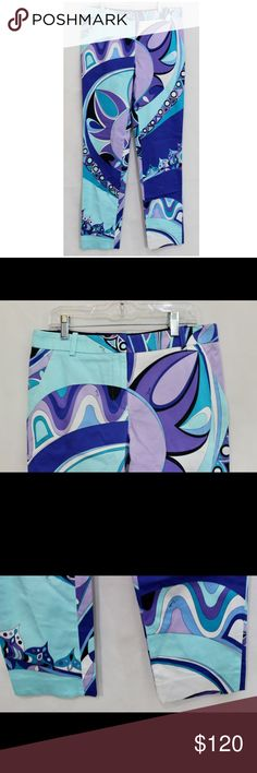 Emilio Pucci Blue Multi Colored Pants Unique stand out pants. With the signature Emilio Pucci print. This is pre owned in Excellent condition. Has some faint marks at front of right leg barely noticeable. These pants are size 4 with a 29 inseam. Cotton blend Emilio Pucci Pants Trousers